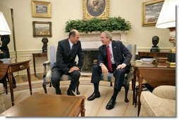 "President George W. Bush meets with Prime Minister Janez Jansa of Slovenia in the Oval Office Monday, July 10, 2006. ""I really appreciate the fact that you have made the courageous decision to help two young democracies, Afghanistan and Iraq, succeed. Your contributions in Afghanistan and Iraq will make a difference in achieving peace. And so thank you for that very much,"" said the President in his remarks to the press."" White House photo by Eric Draper"