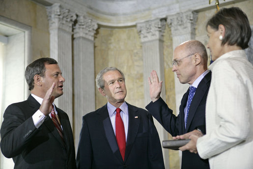 President George W. Bush attends the swearing in of Henry Paulson as the Secretary of Treasury by Supreme Chief Justice John Roberts at the Department of the Treasury Monday, July 10, 2006. White House photo by Eric Draper