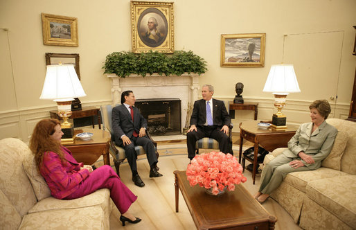 President George W. Bush and Mrs. Laura Bush visit with President Alejandro Toledo of Peru, and his wife and advisor, Mrs. Eliane Karp de Toledo, during a photo opportunity Tuesday, July 11, 2006, in the Oval Office. White House photo by Eric Draper