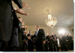 President George W. Bush greets the audience after delivering remarks on the economy and budget, Tuesday, July 11, 2006, in the East Room at the White House. White House photo by Eric Draper