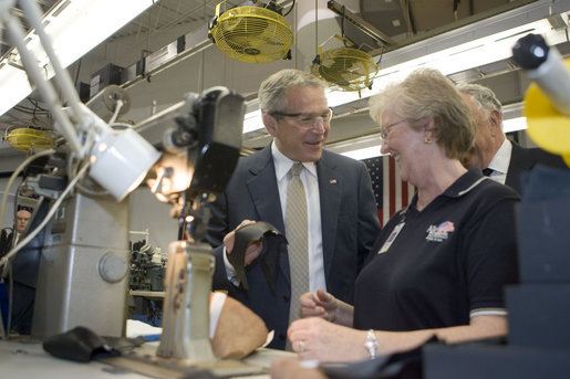 President George W. Bush visits with an employee during a tour of the Allen-Edmonds Shoe Corporation in Port Washington, Wis., Tuesday, July 11, 2006. White House photo by Kimberlee Hewitt