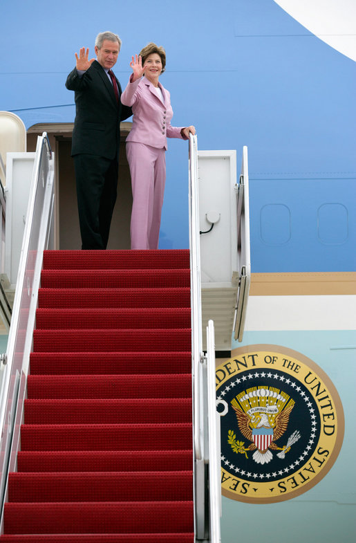 President George W. Bush and Laura Bush wave from Air Force One at Andrews Air Force Base en route to Germany and Russia Wednesday, July 12, 2006. President Bush will meet with Chancellor Angela Merkel in Germany and attend the G8 Summit in St. Petersburg, Russia. White House photo by Eric Draper