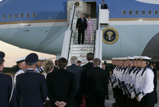 President George W. Bush and Laura Bush are greeted as they arrive Wednesday, July 12, 2006, at Rostock-Laage Airport in Rostock, Germany. The couple later boarded Marine One for a short ride to Heiligendamm, where they are the guests of Germany's Chancellor Angela Merkel before proceeding Friday to the G8 Summit in Russia. White House photo by Eric Draper