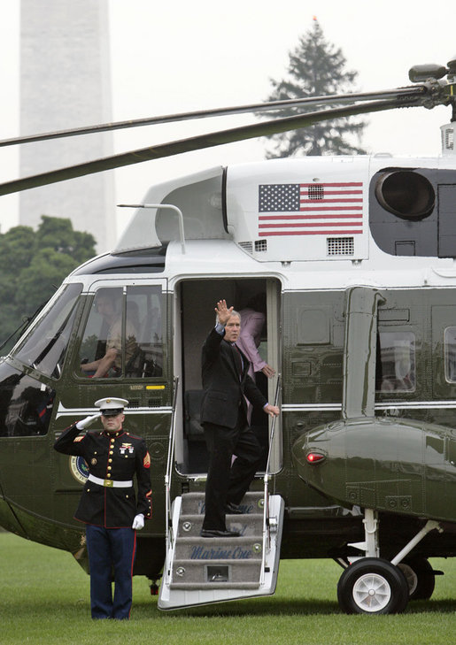 President George W. Bush and Laura Bush board Marine One en route to Germany and Russia on the South Lawn Wednesday, July 12, 2006. President Bush will meet with Chancellor Angela Merkel in Germany and attend the G8 Summit in St. Petersburg, Russia. White House photo by Kimberlee Hewitt
