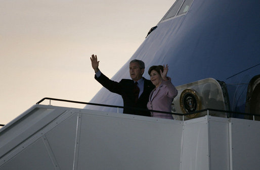 President George W. Bush and Mrs. Laura Bush wave upon arrival of Air Force One to Rostock-Laage Airport in Rostock, Germany. The couple is visiting with Germany's Chancellor Angela Merkel before proceeding to Russia for the G8 Summit. White House photo by Paul Morse