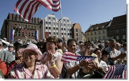 "People crowd the town square of Stralsund, Germany, as Chancellor Angela Merkel welcomes President George W. Bush and Laura Bush Thursday, July 13, 2006. ""And in 1989, it was also one of the many cities where on Monday demonstrations took place, where people went out into the streets to demand freedom, to demonstrate for freedom,"" said Chancellor Merkel. White House photo by Eric Draper"