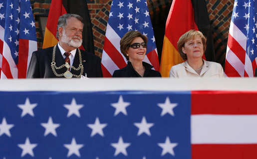 Mrs. Laura Bush is seated between Stralsund Mayor Harald Lastovka and German Chancellor Angela Merkel during the welcoming ceremony Thursday, July 13, 2006, in honor of the visit by President George W. Bush and Laura Bush to Stralsund, Germany. White House photo by Eric Draper