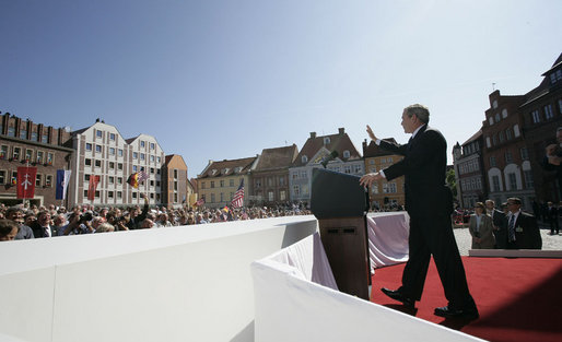 "President George W. Bush addresses the crowded town square of Stralsund, Germany, before meeting with Chancellor Angela Merkel Thursday, July 13, 2006. ""For decades, the German people were separated by an ugly wall. Here in the East, millions of you lived in darkness and tyranny,"" said President Bush. ""Today your nation is whole again. The German people are at the center of Europe that is united and free and peaceful."" White House photo by Eric Draper"