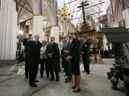 German Chancellor Angela Merkel, President George W. Bush and Laura Bush tour St. Nikolai Church in Stralsund, Germany, Thursday, July 13, 2006. White House photo by Eric Draper