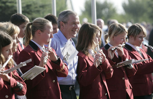 President George W. Bush joins members of the Jagdhornblaser Baremerhagen Band Thursday, July 13, 2006, prior to dinner in Trinwillershagen, Germany. The President and Mrs. Laura Bush depart Germany Friday for Russia and the G8 Summit. White House photo by Eric Draper