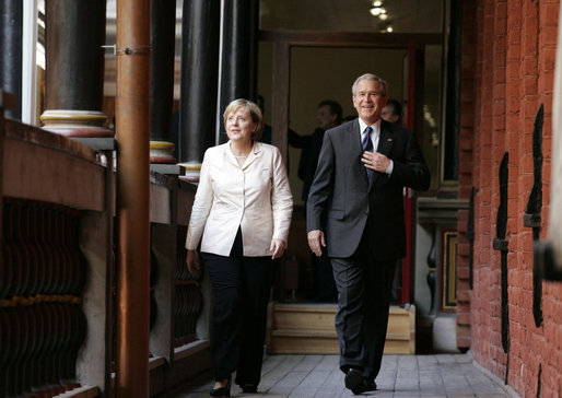 Chancellor Angela Merkel and President George W. Bush walk to their meeting after the arrival ceremony in Stralsund, Germany, Thursday, July 13, 2006. White House photo by Paul Morse