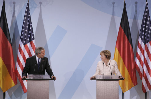 "President George W. Bush and Chancellor Angela Merkel hold a joint press conference in Stralsund, Germany, Thursday, July 13, 2006. ""We had a good discussion -- it's more than a discussion, it's really a strategy session, is the way I'd like to describe it,"" said President Bush. ""We talked about a lot of subjects. We talked about the Middle East and Iran, and I briefed the Chancellor on North Korea. We talked about Iraq and Afghanistan, as well."" White House photo by Paul Morse"