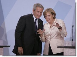 President George W. Bush and Chancellor Angela Merkel hold a joint press conference in Stralsund, Germany, Thursday, July 13, 2006.  White House photo by Paul Morse