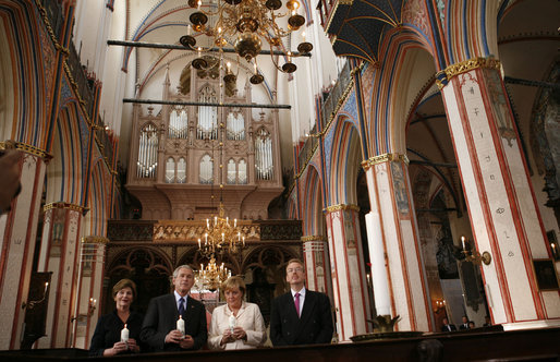 President George W. Bush and Laura Bush stand with German Chancellor Angela Merkel and Pastor Peter Neumann in St. Nikolai Church in Stralsund, Germany, Thursday, July 13, 2006. White House photo by Paul Morse
