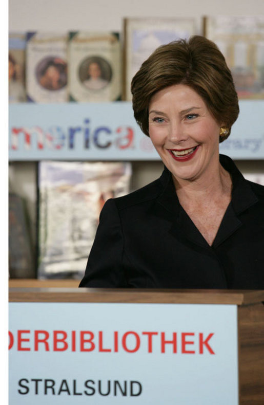 Mrs. Laura Bush speaks to school children during a visit Thursday, July 13, 2006, to the Stralsund Children's Library in Stralsund, Germany, where Mrs. Bush participated in the ribbon cutting to open the exhibit America@yourlibrary. The America@yourlibrary is a new initiative to develop existing and new partnerships between German public libraries and the U.S. Embassy and Consulate Resource Centers. White House photo by Shealah Craighead