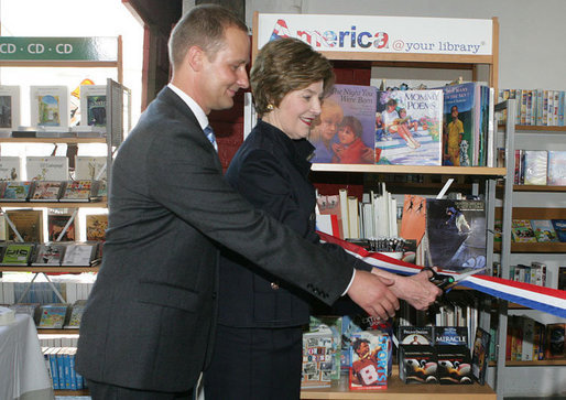 Mrs. Laura Bush participates in a ribbon cutting, assisted by Michael Gawenda, director of the City Library of Stralsund, Thursday, July 13, 2006, at the Stralsund Children's Library in Stralsund, Germany, to open the exhibit America@yourlibrary. The America@yourlibrary is a new initiative to develop existing and new partnerships between German public libraries and the U.S. Embassy and Consulate Resource Centers. White House photo by Shealah Craighead