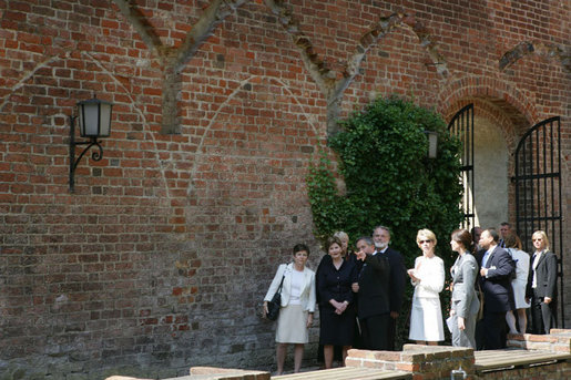 Mrs. Laura Bush is escorted on a tour outside the City of Stralsund Archives in Stralsund, Germany, Thursday, July 13, 2006, by Dr. Hans-Joachim Hacker, director of the City of Stralsund Archives. White House photo by Shealah Craighead