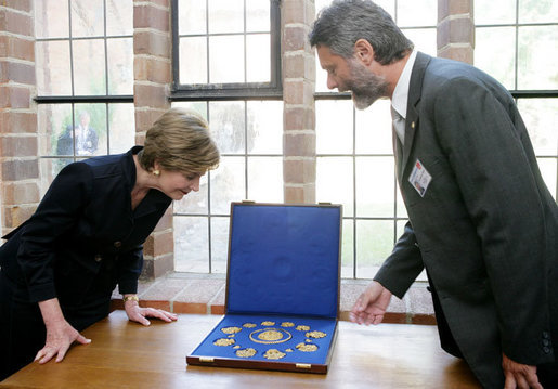 Mrs. Laura Bush is shown jewelry artifacts on her tour of the City of Stralsund Archives in Stralsund, Germany, Thursday, July 13, 2006, by Dr. Andreas Gruger, director of the Stralsund Museum of Cultural History. White House photo by Shealah Craighead