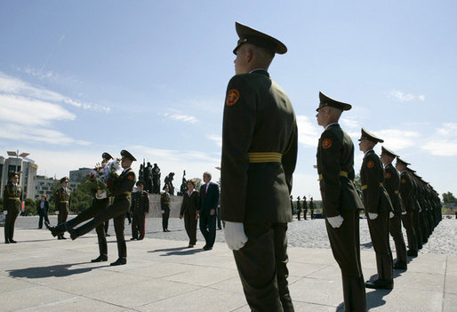 President George W. Bush and Laura Bush follow a Russian honor guard to place a wreath at the Monument to the Heroic Defenders of Leningrad, Friday, July 14, 2006, in St. Petersburg, Russia. White House photo by Eric Draper