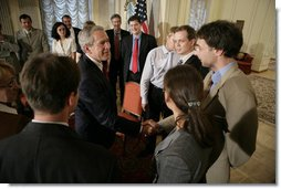President George W. Bush meets participants at the roundtable discussion with Civil Society at the Consul General's residence, Friday, July 14, 2006 in St. Petersburg, Russia.  White House photo by Eric Draper