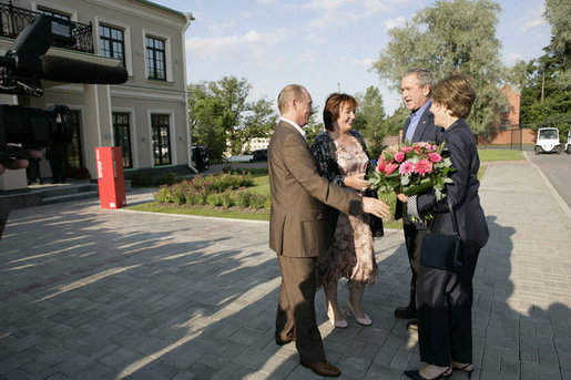 President George W. Bush and Laura Bush are greeted by Russian President Vladimir Putin and his wife, Lyudmila, upon their arrival Friday, July 14, 2006, for a social dinner at the Konstantinovsky Palace in Strelna, Russia. White House photo by Eric Draper