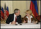 President George W. Bush talks with Irina Yasina , a representative of Open Russia, at a roundtable discussion with Civil Society at the Consul General's residence, Friday, July 14, 2006 in St. Petersburg, Russia. White House photo by Eric Draper