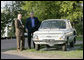 President George W. Bush and Russian President Vladimir Putin look over the first car owned by President Putin, a Zaporozhets, Friday, July 14, 2006, before they attend a social dinner at the Konstantinovsky Palace in Strelna, Russia. White House photo by Eric Draper