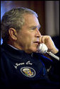 President George W. Bush calls world leaders concerning the situation in the Middle East from his Air Force One office en route to the G8 Summit in St. Petersburg, Russia, Friday, July 14, 2006. White House photo by Eric Draper