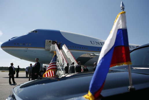 President George W. Bush and Mrs. Laura Bush wave from Air Force One upon arriving at Pulkovo International Airport for the upcoming G8 Summit in St. Petersburg, Russia, Friday, July 14, 2006. White House photo by Paul Morse