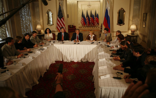 Participants join President George W. Bush Friday, July 14, 2006, at the Consul General's Residence in St. Petersburg, Russia, for a roundtable with the Civil Society organization. White House photo by Paul Morse