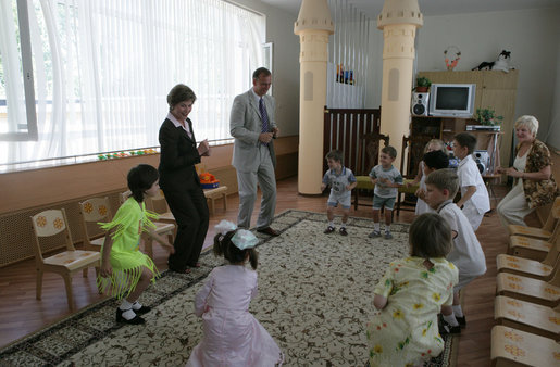 Mrs. Laura Bush dances with youngsters Friday, July 14, 2006, at the Pediatric HIV/AIDS Clinical Center of Russia in St. Petersburg, Russia. White House photo by Shealah Craighead