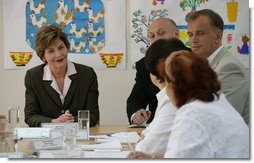 Mrs. Laura Bush listens to roundtable participants Friday, July 14, 2006, during a tour of the Pediatric HIV/AIDS Clinical Center of Russia in St. Petersburg, Russia. White House photo by Shealah Craighead