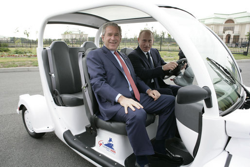 President George W. Bush is escorted by President Vladimir Putin of Russia, as they drive an electric GEM car to the Bilateral Meeting Room at the Konstantinovsky Palace Complex, site of the G8 Summit Saturday, July 15, 2006, in Strelna, Russia. White House photo by Eric Draper