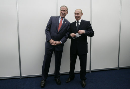 President George W. Bush and President Vladimir Putin of Russia, pose briefly for photographers before their joint press availability Saturday, July 15, 2006, during the G8 Summit in Strelna, Russia. White House photo by Eric Draper