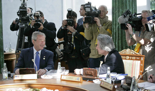President George W. Bush talks with Japanese Prime Minister Junichiro Koizumi during a working session at the G8 Summit in Strelna, Russia, Sunday, July 16, 2006. White House photo by Eric Draper