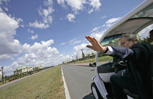 President George W. Bush drives his electric GEM car to a meeting during the G8 Summit at Konstantinvosky Palace Complex in Strelna, Russia, July 16, 2006. Each of the G8 leaders is provided with a car that is decorated with the flag of the leader's nation. White House photo by Eric Draper