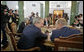 President George W. Bush talks with Russian President Vladimir Putin during a working session at the G8 Summit in Strelna, Russia, Sunday, July 16, 2006. White House photo by Eric Draper