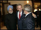 President George W. Bush embraces India�s Prime Minister Dr. Manmohan Singh, left, and Brazilian President Luiz Inacio Lula da Silva, right, at the Konstantinovsky Palace Complex Monday, July 17, 2006. President Bush met with the two leaders separately in bilateral meetings during the G8 Summit in Strelna, Russia.  White House photo by Eric Draper
