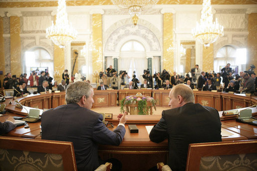 President George W. Bush sits next to Russian President Vladimir Putin during a working session at the G8 Summit at the Konstantinovsky Palace Complex in Strelna, Russia, July 17, 2006. White House photo by Eric Draper