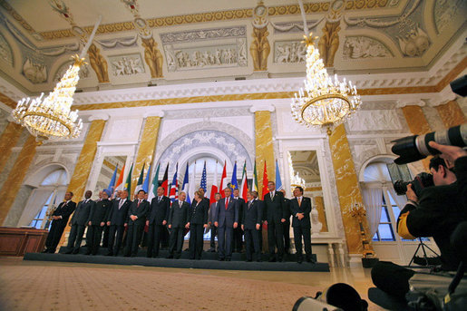 President George W. Bush poses with fellow G8 leaders, invited leaders and heads of international organizations for a group photograph at Konstantinvosky Palace in Strelna, Russia, Monday, July 17, 2006. White House photo by Paul Morse