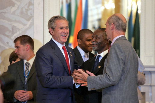 President George W. Bush talks with South African President Thabo Mbeki, center, and World Trade Organization Chief Pascal Lamy during the G8 Summit at Konstantinvosky Palace in Strelna, Russia, Monday, July 17, 2006. White House photo by Paul Morse