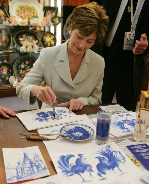 Mrs. Laura Bush participates in an arts and crafts demonstration Monday, July 17, 2006, during an exhibit at the Baltic Star Hotel on the grounds of the Konstantinovsky Palace Complex in Strelna, Russia, site of the G8 Summit that ended Monday. White House photo by Shealah Craighead