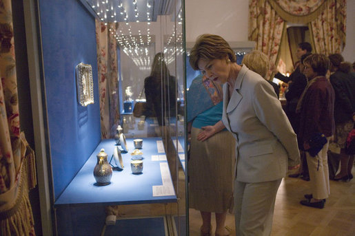 Laura Bush looks over a display piece Monday, July 17, 2006, at a Hermitage Exhibit for G8 spouses at the Konstantinovsky Palace Complex in Strelna, Russia, site of the 2006 G8 Summit that ended Monday. White House photo by Shealah Craighead