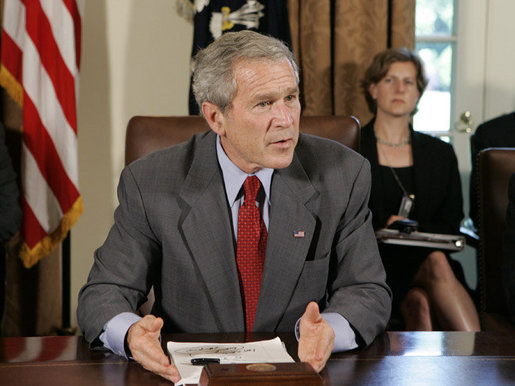 President George W. Bush answers a reporter's question Tuesday, July 18. 2006, in the Cabinet Room at the White House, about ongoing events in the Middle East, during President Bush's meeting with bipartisan members of Congress about his trip to the G8 Summit. White House photo by Kimberlee Hewitt