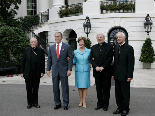 President George W. Bush and Laura Bush welcome outgoing Archbishop of Washington Theodore Cardinal McCarrick, left, the incoming Archbishop of Washington Donald W. Wuerl, right, and Papal Nuncio Pietro Sambi to the White House Tuesday evening, July 18, 2006, for a dinner in their honor. White House photo by Kimberlee Hewitt