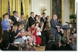 "President George W. Bush delivers remarks about stem cell research policy legislation in the East Room Wednesday, July 19, 2006. ""Each of these children was adopted while still an embryo, and has been blessed with the chance to grow up in a loving family,"" said the President of children sharing the stage with him. ""These boys and girls are not spare parts. They remind us of what is lost when embryos are destroyed in the name of research."" White House photo by Kimberlee Hewitt"