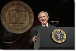 President George W. Bush receives a warm welcome from the delegates and guests at the annual convention of the National Association for the Advancement of Colored People (NAACP), as he prepares to deliver his remarks Thursday, July 20, 2006 in Washington, D.C.  White House photo by Eric Draper