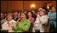 Mrs. Laura Bush applauds the speakers participating in the National Endowment for the Arts 'Big Read' event Thursday, July 20, 2006, at the Library of Congress in Washington. The 'Big Read' is a new program to encourage the reading of classic literature by young readers and adults. White House photo by Shealah Craighead