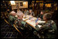 President George W. Bush meets with U.S.military service personnel who have recently returned from duty in Iraq and Afghanistan to hear about their experiences Friday, July 21, 2006, at Tamale Fiesta Kitchen restaurant in Aurora, Colorado. White House photo by Eric Draper