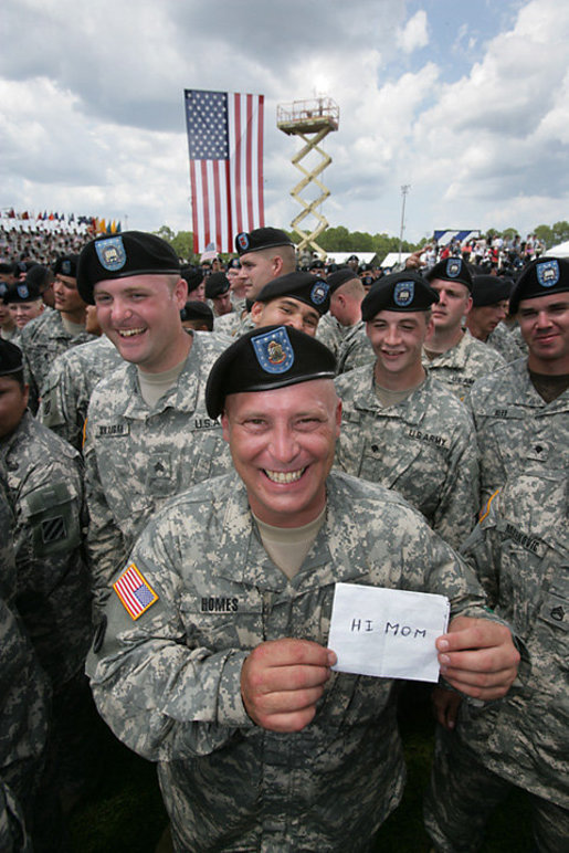 At a rally for the troops attended by Vice President Dick Cheney at Fort Stewart, Ga., a soldier from the Army's 3rd Infantry Division holds up a message to mom for photographers, Friday, July 21, 2006. White House photo by David Bohrer